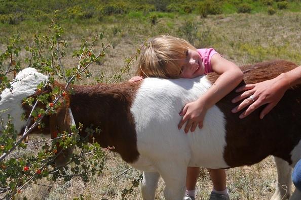 girl-hugging-goat.jpg