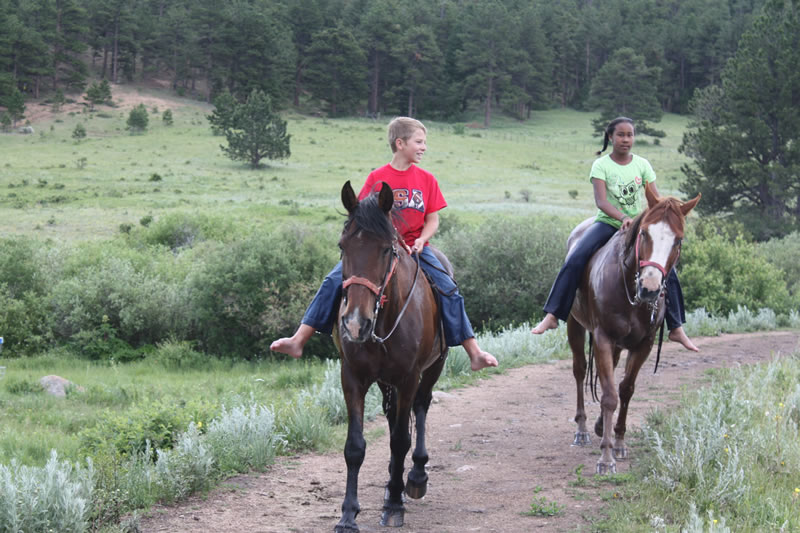 boy-girl-horseback-riding.jpg